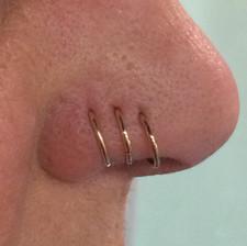 nostril piercing with hoop