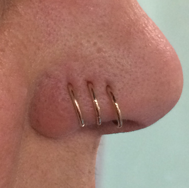 nostril piercing with hoop