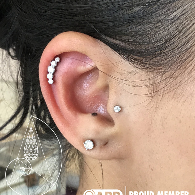 helix piercing with industrial strength swarovski cluster