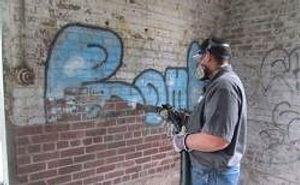 Dustless Blasting Graffiti Removal Stock Photo