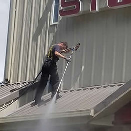 moss patrol pressure washing metal commercial roof