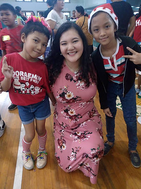 Katrina with children.jpg