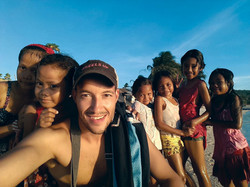 Elliot with kids on the beach
