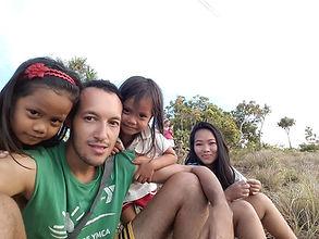 AMA Elliot with children in the Philippines.