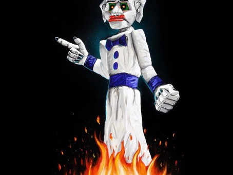 Zozobra; A Dancing, Burning Marionette and Insignia of Gloom