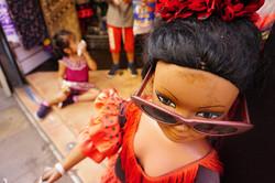 Girl on floor of Spanish kiosk