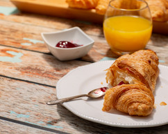 Continental Breakfast on a Rustic Table Surface