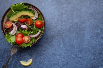 Healthy Salad Bowl on Blue Slate
