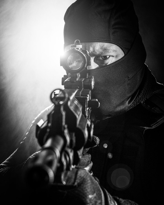 Actor with automatic rifle