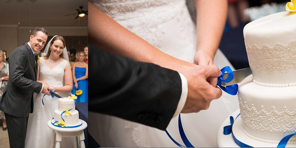 husband and wife cutting the cake
