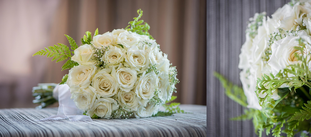 white roses and babies breath bouquet
