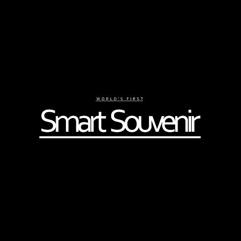 A black box with white border and the middle inlcuded text that says world's first smart souvenir. Inside the black box there is a small white box in the bottom part with Learn more text