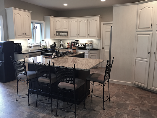 East Hempfield, PA | Oak kitchen cabinets painted white with custom glaze finish