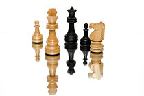 photo-of-black-and-beige-wooden-chess-pi