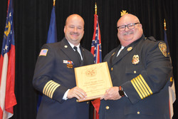 Chief Watson presents a plaque to Chief