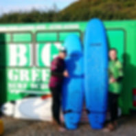 Big Green Surf School surf & SUP coach Ross teaching a private surf lesson on Crantock Beach Cornwall