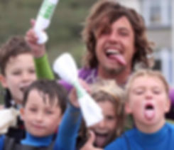 Big Green Surf School surf coach Laurie teaching our kids surf club in Crantock Cornwall