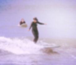 Big Green Surf School surf coach T dawn surfing longboarding at Crantock Beach Cornwall