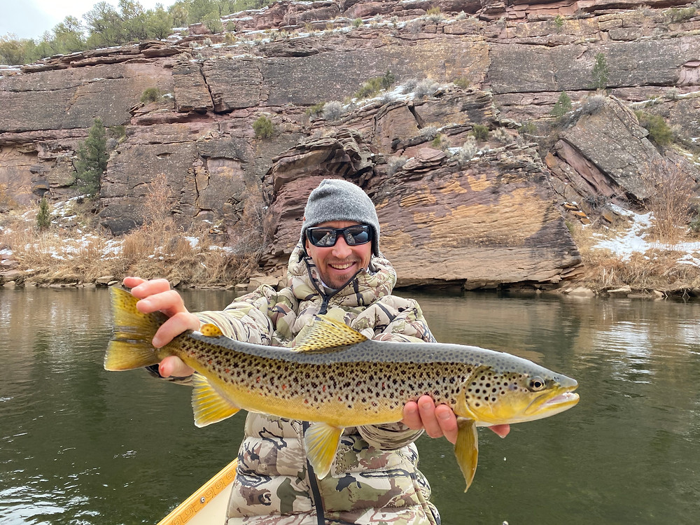 Fly Fishing Guide JD Magee with a streamer caught Brown Trout