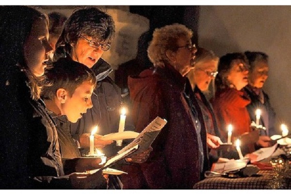 Carol singing by candle light