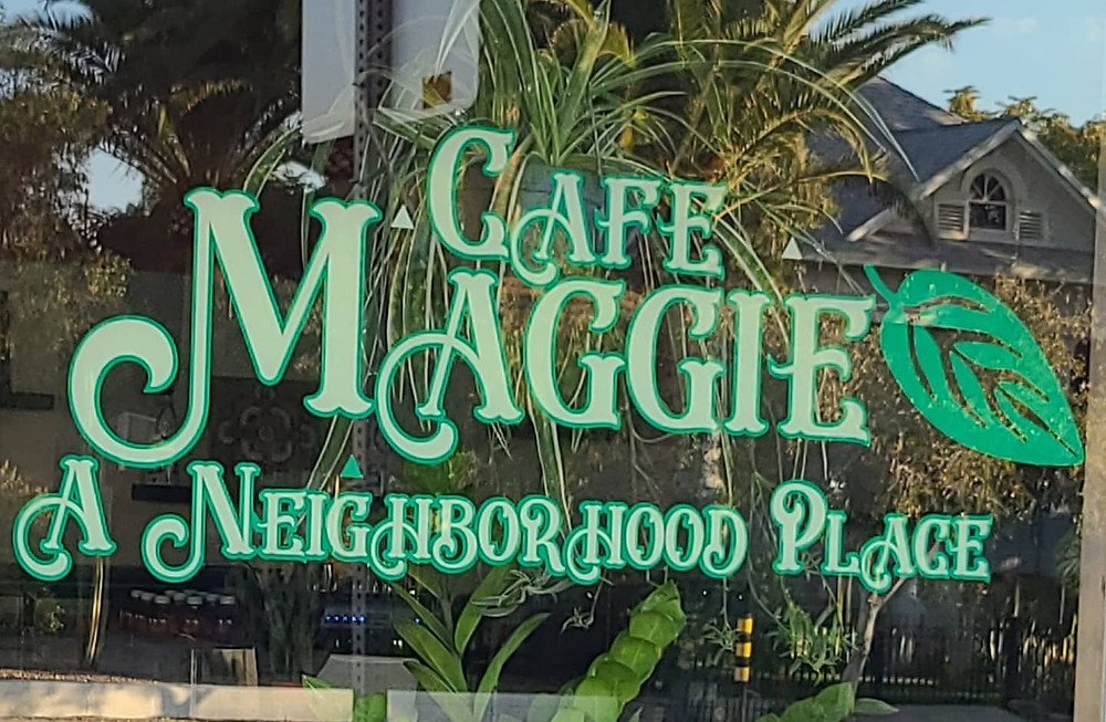 Close up image of the Cafe Maggie logo on their front window