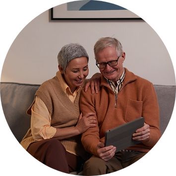 old-couple-sitting-together-looking-at-ipad