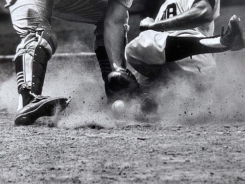 an amazing detail photograph of a close baseball play.jpg