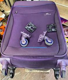 Замена колес на чемоданах.jpg