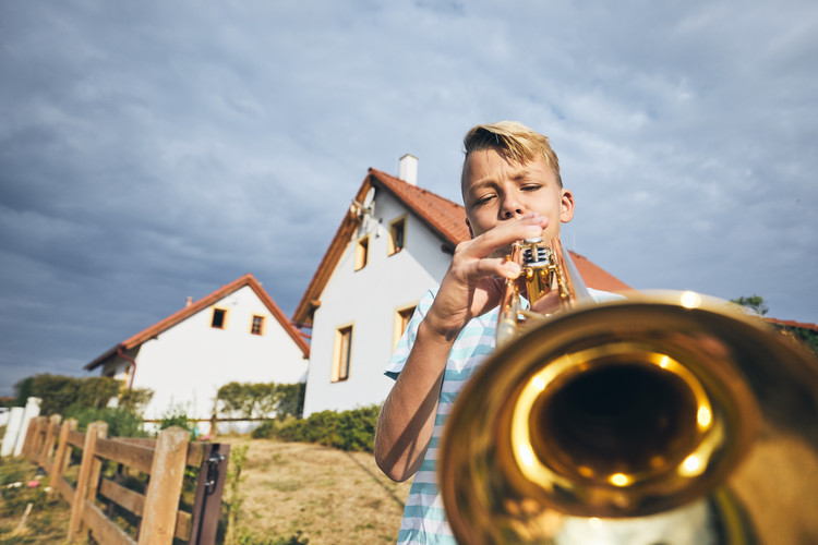 little-boy-playing-the-trumpet-JW6ULYP.j