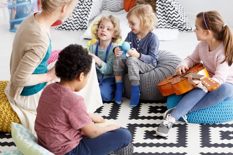 sitting-on-a-carpet-P8BAWTX.jpg