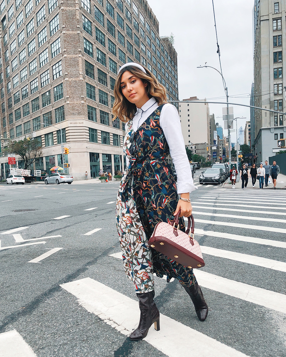 Blogger Barbie Brignoni wearing a shirt dress under a scarf printed dress with knee high croc boots for NYFW