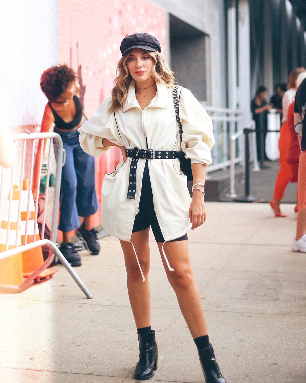 Blogger Barbie Brignoni wearing a vintage jacket with the biggest sleeves I've ever seen, biker shorts for NYFW.