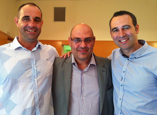Lucas Mondelo, a Spanish national team coach, takes a picture with José Antonio Nevada and Francisco Caballero, the co-founders of Barcel'Hona Sports Events.