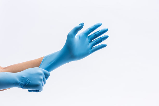 Human holding Variation of Latex Glove,