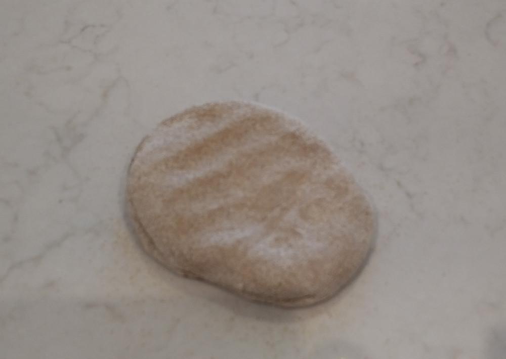 Sixth dough ball floured