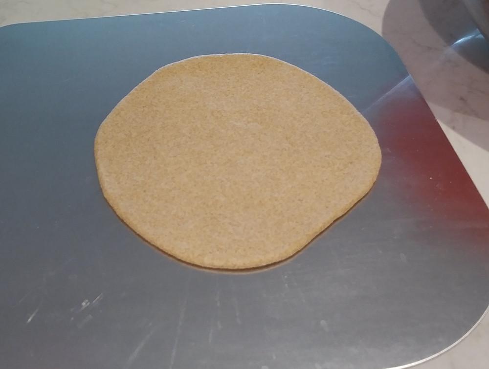 Second dough disc on peel