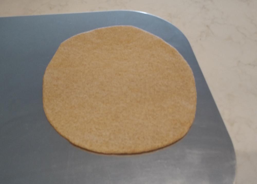 Sixth dough disc on peel