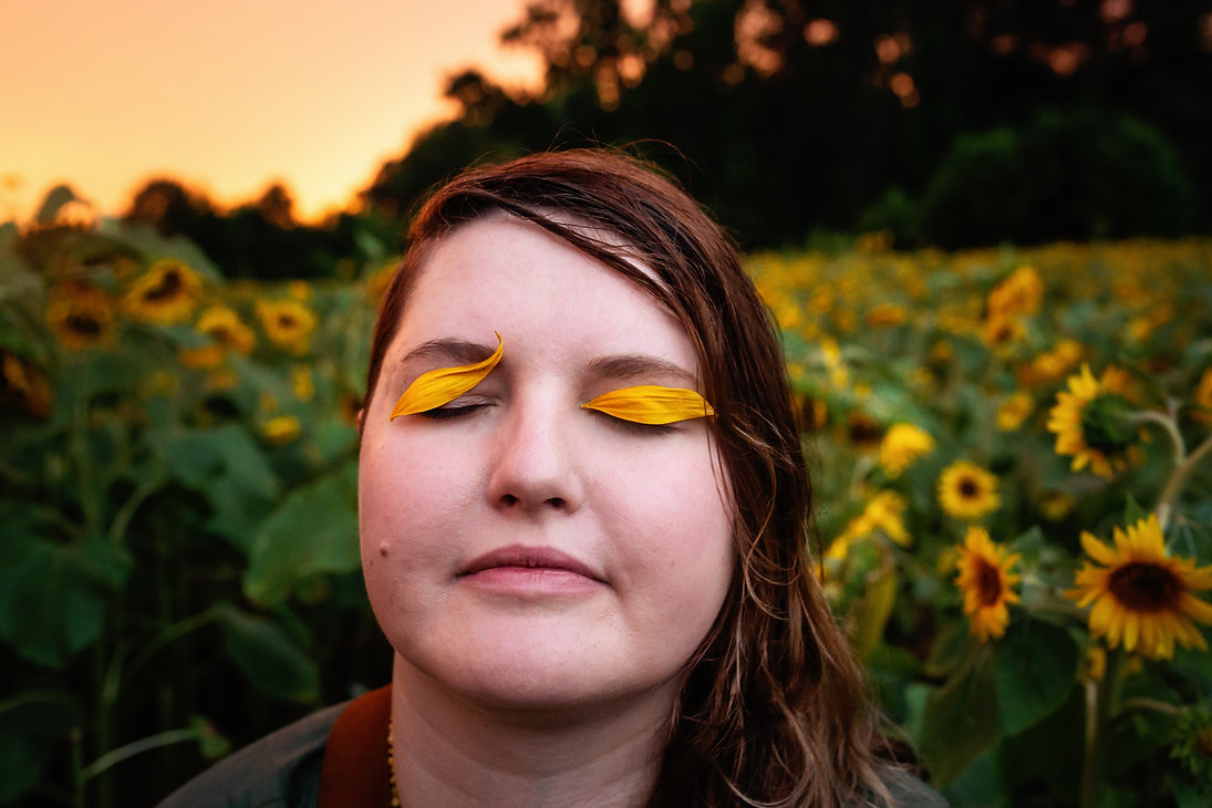 Birth Keeper with sunflower petals on her eyelids