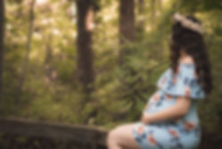 pregnant mothr gazing into tranquil woods