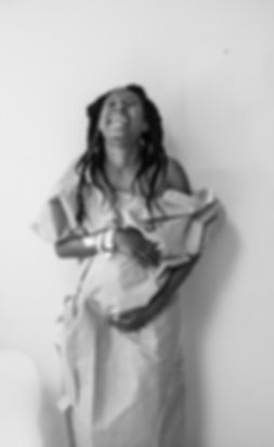 A joyus woman of color moments before her empowering cesarean birth