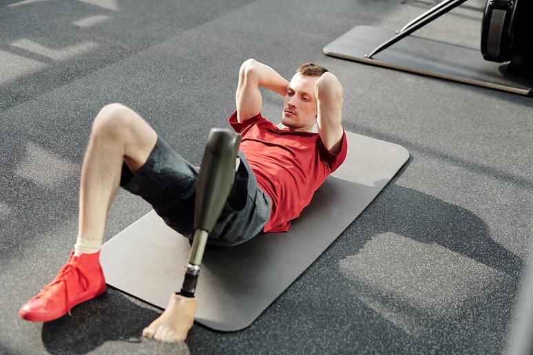man-in-red-tank-top-lying-on-gray-yoga-m