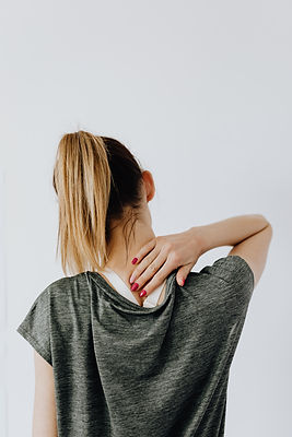 anonymous-female-with-spinal-pain-on-whi