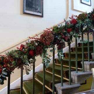 Caroline Clements wedding Flowers stairs garland
