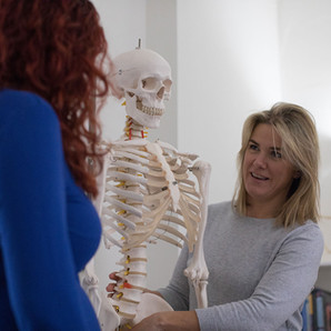 pregnant woman getting back treatment at move move chiropractic clinic in cheltenham