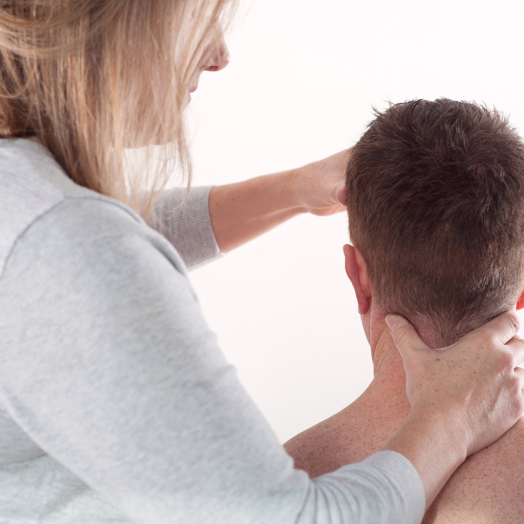 man getting neck treatment at move move chiropractic clinic in cheltenham