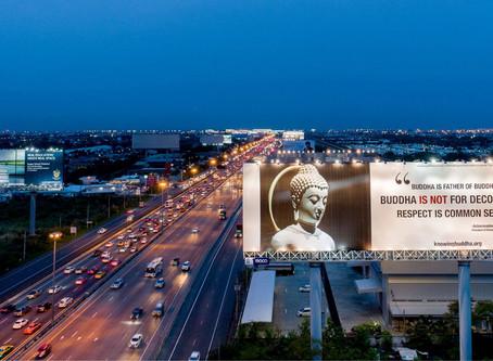 ์New Buddhist Protection billboard set run by Knowing Buddha Organization.