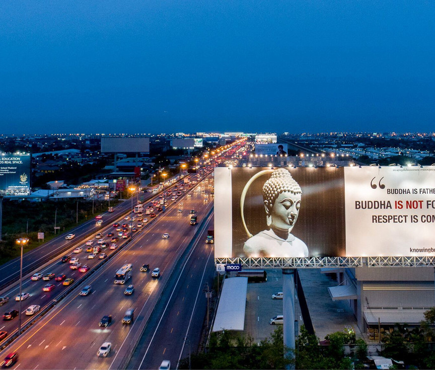 ์New Buddhist Protection billboard set run by Knowing Buddha Organization.