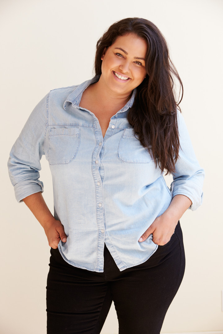 Studio Portrait Of Smiling Overweight Wo