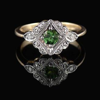 Engagement ring: Handmade tsavorite garnet and diamond ring in white and rose gold.