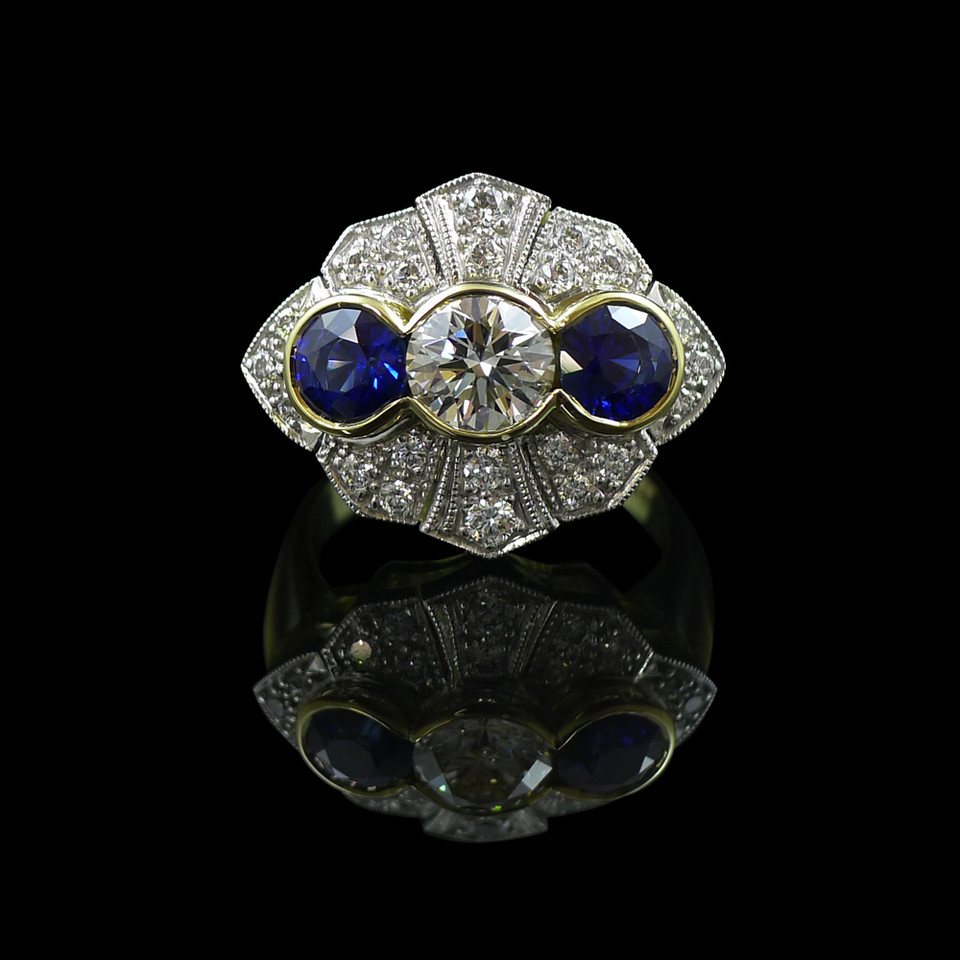 Engagement ring: Handmade engagement ring in 18 carat yellow and white gold, with sapphires and diamonds.